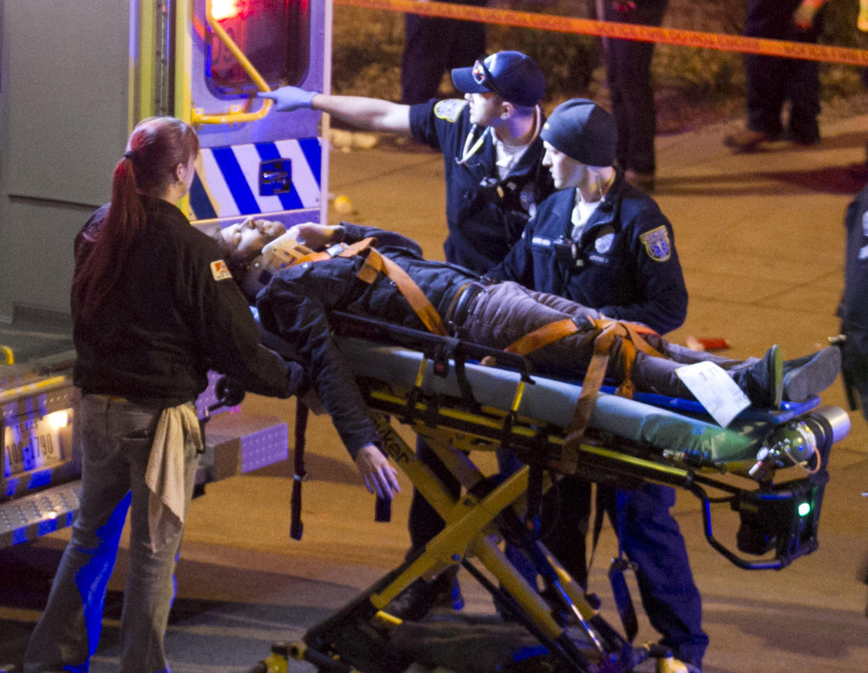 A man is transported to an ambulance after being struck by a vehicle on Red River Street in downtown Austin, Texas, on Wednesday March 12, 2014. Police say two people were confirmed dead at the scene after a car drove through temporary barricades set up for the South By Southwest festival and struck a crowd of pedestrians. The condition of the man is unknown. (AP Photo/Austin American-Statesman, Jay Janner)