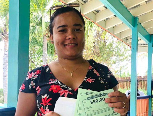 PHOTO: A woman receives her COVID-19 Food Vouchers from the Blanchards Anguilla Children's Fund. (Blanchards Anguilla Children's Fund)