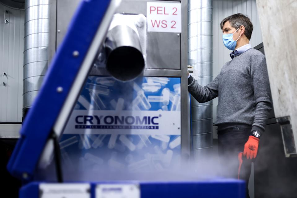 Christophe Cuigniez, CEO of Cryonomic, a Belgium's company producing dry ice machines and containers which will be used for Covid-19 vaccines transportation, prepares dry ice in Ghent on December 2, 2020. (Photo by Kenzo TRIBOUILLARD / AFP) (Photo by KENZO TRIBOUILLARD/AFP via Getty Images)
