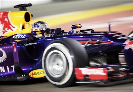 Red Bull Formula One driver Sebastian Vettel of Germany races during the Singapore F1 Grand Prix at the Marina Bay street circuit in Singapore September 22, 2013. REUTERS/Tim Chong