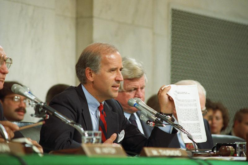 Biden holding up a copy of the FBI report on Hill during the 1991 committee hearings on Thomas. (Bettmann via Getty Images)