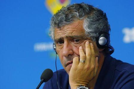 Greece's national soccer team head coach Fernando Santos listens to a question at a news conference at the Pernambuco arena in Recife