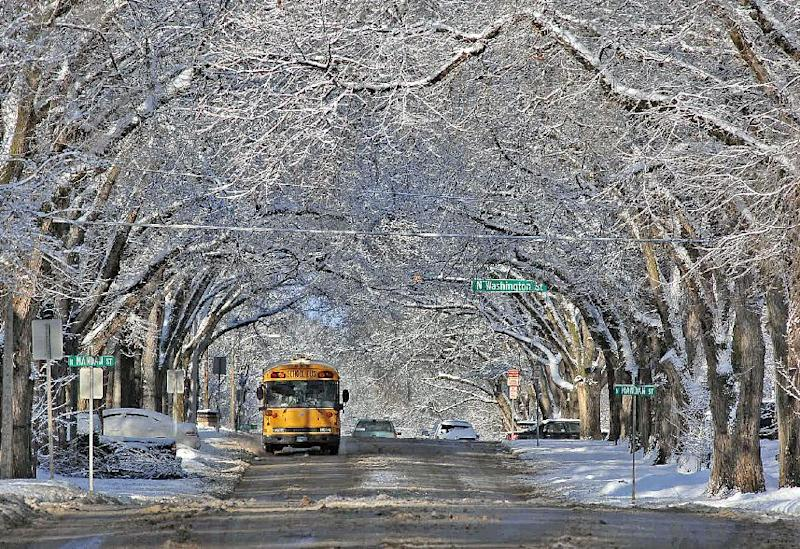 Snow-covered trees form a scenic canopy over Avenue C in Bismarck on Monday, March 4, 2013, in the wake of a slow moving winter storm that passed through the state leaving southern areas of North Dakota with rain that later turned to snow. Northern areas of the state received significant snowfall totals causing school closings and many cancellations of scheduled events and travel advisories. (AP Photo/The Bismarck Tribune, Tom Stromme)
