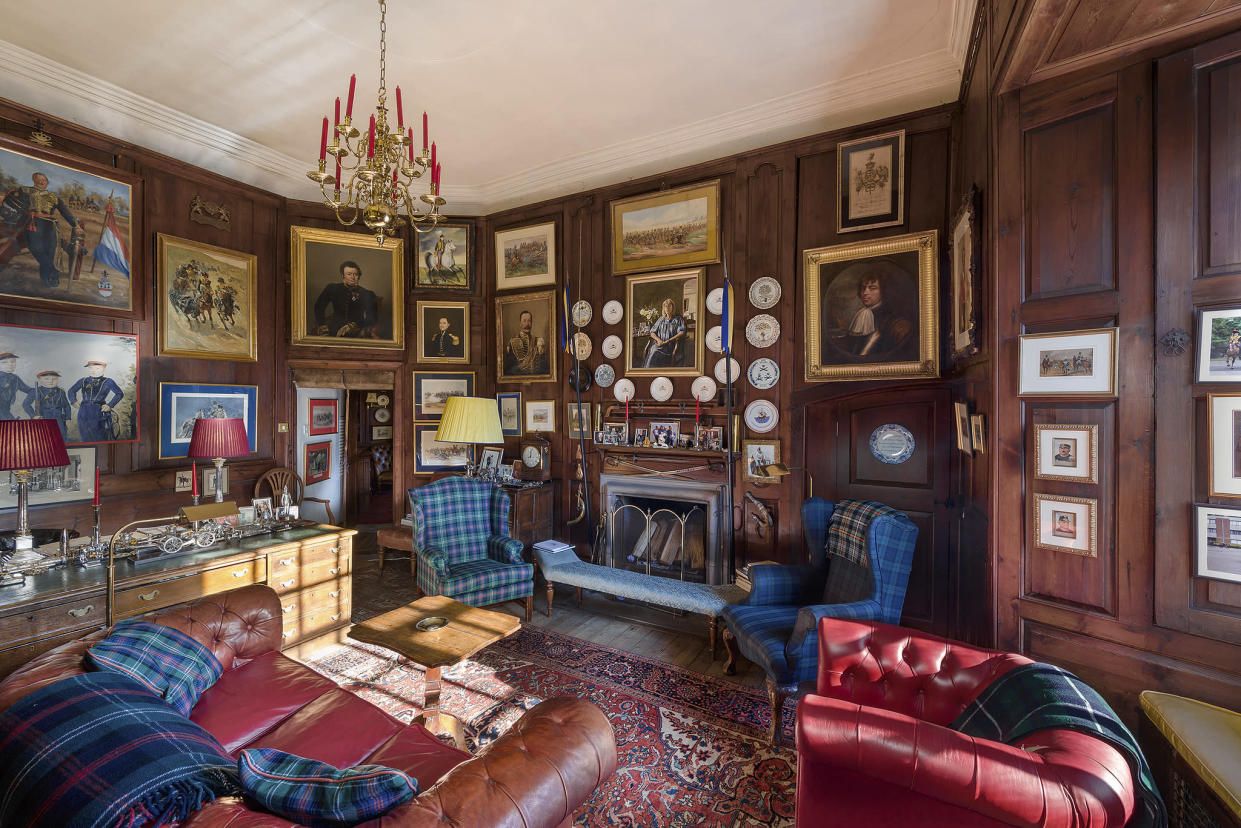This plush wood-panelled room could be yours - yes please (Image: Savills)