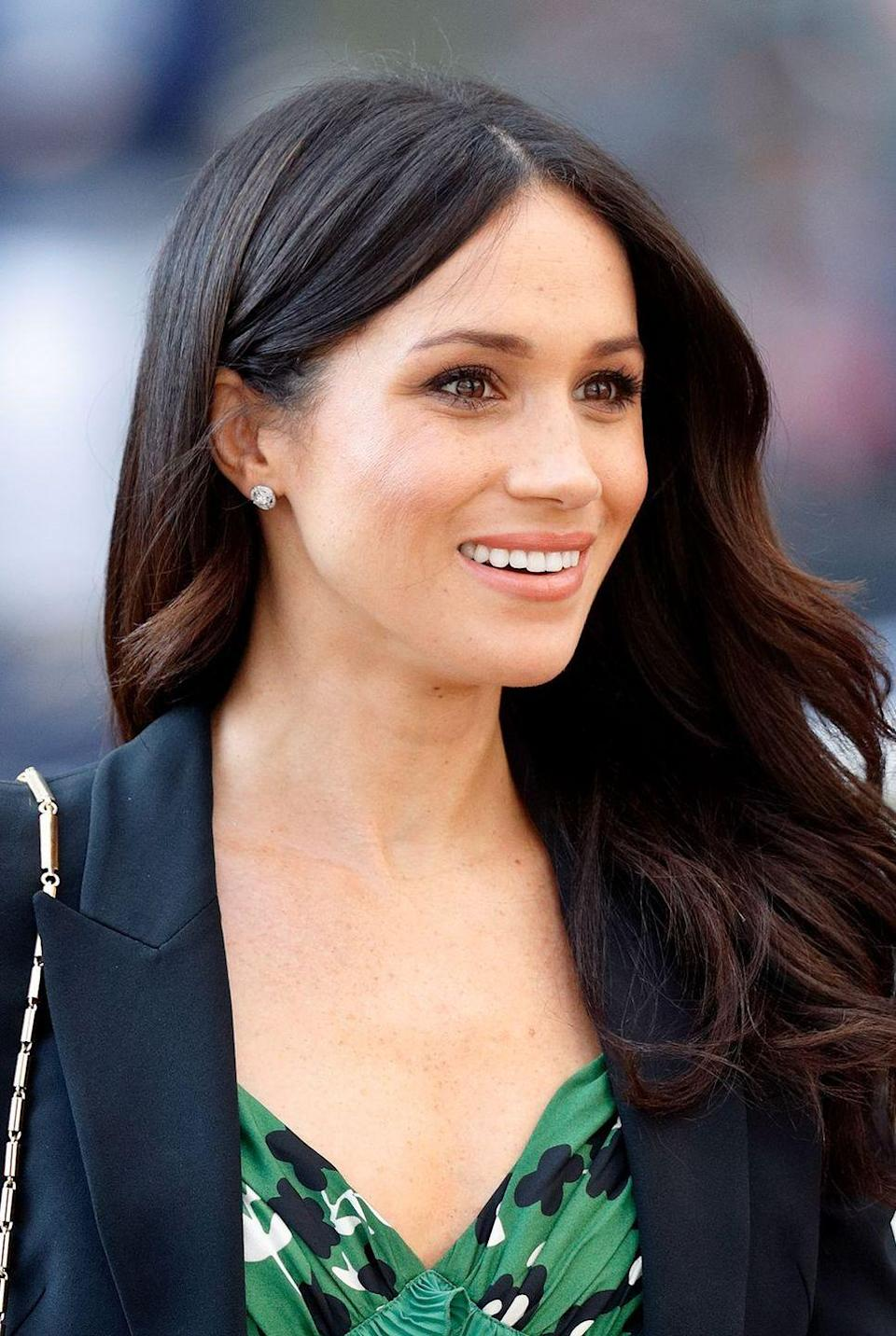 """<p>Pump out 15 reps of ... smiling? """"I do facial exercises from one of my favourite aestheticians, Nicola Joss, who basically has you sculpt your face from the inside out,"""" the Duchess of Sussex told <a href=""""https://www.birchbox.com/magazine/article/meghan-markle-suits-beauty-secrets?"""" rel=""""nofollow noopener"""" target=""""_blank"""" data-ylk=""""slk:Birchbox"""" class=""""link rapid-noclick-resp"""">Birchbox</a> in 2014. """"I swear it works, as silly as you may feel. On the days I do it, my cheekbones and jawline are way more sculpted.""""</p>"""