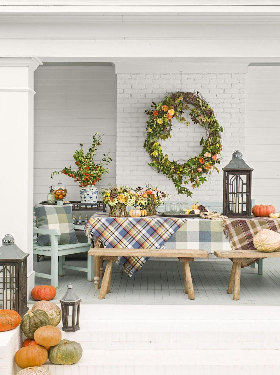 <p>Two tartan beauties turn this back porch table into a work of art. (The oversize wreath certainly doesn't hurt either.) </p>