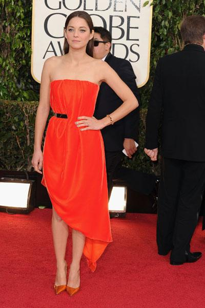 Marion Cotillard: The always-stunning 'Rust and Bone' actress is the epitome of Paris chic in a simple strapless red dress with a metal belt and diagonal hem. But the best part of her looj is her simple straight hair! (Photo by Steve Granitz/WireImage)