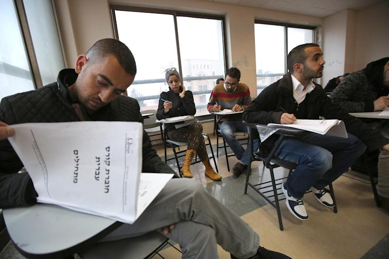Palestinian photojournalist Fadi Arouri (L) is one of about 30 Palestinian journalists taking two hours of Hebrew classes a week in a bid to better read Israeli newspapers and cover the conflict (AFP Photo/Abbas Momani)