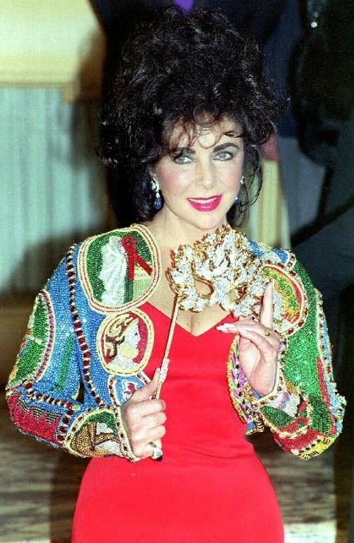 Following Elizabeth Taylor's death in 2011 at age 79, a week-long auction in New York of her vast collection of luxury dresses, jewels and fine art saw total sales topping $153 million (AFP Photo/HELAYNE SEIDMAN)