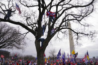 Trump supporters participate in a rally Wednesday, Jan. 6, 2021 in Washington. As Congress prepares to affirm President-elect Joe Biden's victory, thousands of people have gathered to show their support for President Donald Trump and his baseless claims of election fraud. The president is expected to address a rally on the Ellipse, just south of the White House. (AP Photo/John Minchillo)