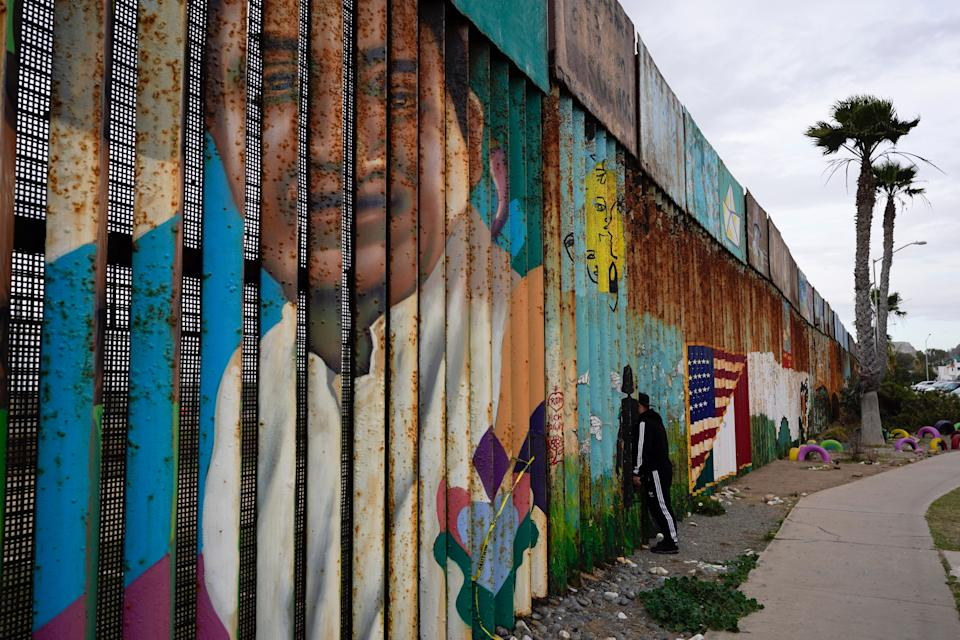 <p>A man looks through the first wall at Friendship Park, near where the border separating Tijuana, Mexico, and San Diego meets the Pacific Ocean Tuesday, Jan. 19, 2021, in Tijuana, Mexico.</p> (Associated Press)