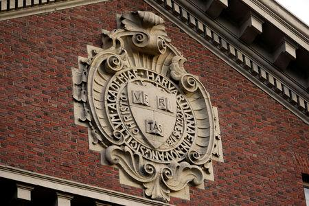 A seal hangs over a building at Harvard University in Cambridge