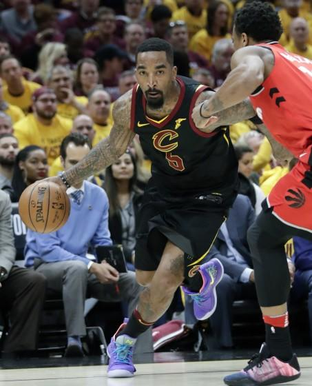 FILE - In this May 7, 2018, file photo, Cleveland Cavaliers' J.R. Smith (5) drives on Toronto Raptors' DeMar DeRozan in the first half of Game 4 of an NBA basketball second-round playoff series, in Cleveland. Smith's never-a-dull-moment run with the Cavaliers is over. Cleveland released the colorful shooting guard Monday, July 15, 2019, before his $15.6 million contract for next season became guaranteed. The Cavs had been trying to trade Smith for months, but the team was unable to find the right deal even after he agreed to extend his guarantee date from June 30 to July 15. (AP Photo/Tony Dejak, File)