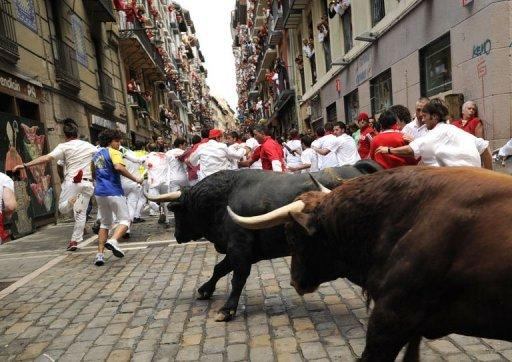 Runners try to avoid El Pilar bulls during the fourth run of the bulls of the San Fermin festival in the northern Spanish city of Pamplona. Five Spaniards aged between 19 and 47 suffered bruises to their shoulders, legs, ankles and head in a dash through the northern city of Pamplona, regional health authorities said