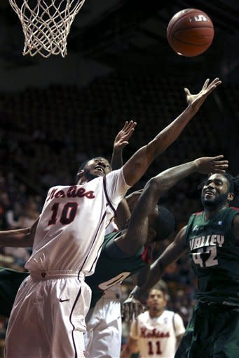 Virginia Tech's Marcus Rankin (10) reaches for a defensive rebound over Mississippi Valley State's Davon Usher, center, and Montreal Holley (42) during the first half of an NCAA college basketball game, Monday, Dec. 10, 2012, in Blacksburg, Va. (AP Photo/The Roanoke Times, Matt Gentry)
