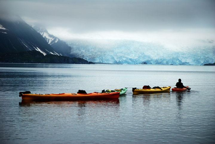 Ailiak Glacier, Alaska - After being dropped off a quarter mile away from our cabin near Ailiak Glacier, our guide towed the kayaks to a better landing spot in the still, glassy waters of the Alaskan wilderness. © World Wildlife Fund/Michael Ciaglo