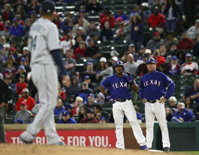 Texas Rangers' Adrian Beltre (29) yells out to Seattle Mariners starting pitcher Felix Hernandez (34) after being hit by a pitch during the sixth inning of an baseball game Friday, April 20, 2018, in Arlington, Texas. (AP Photo/Richard W. Rodriguez)