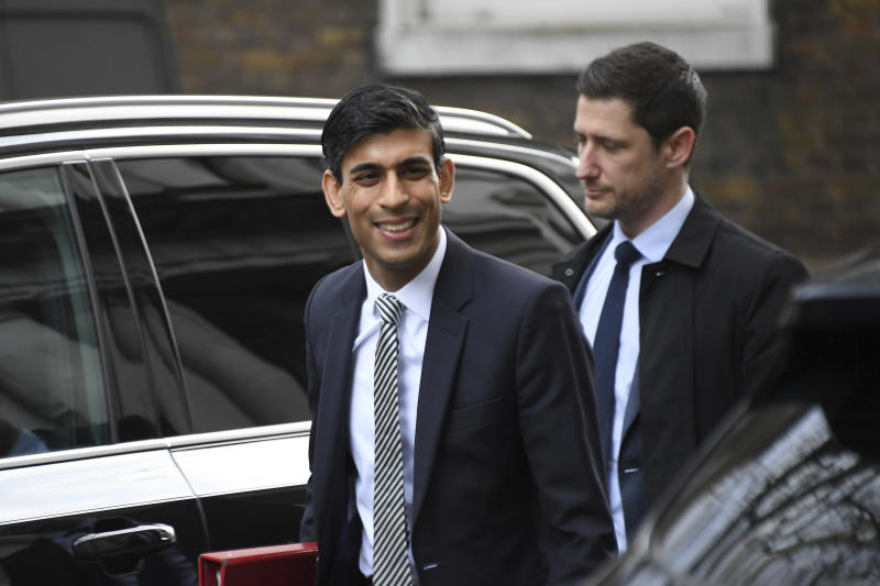 British lawmaker Rishi Sunak, the Chancellor of the Exchequer arrives for a Cabinet meeting at 10 Downing Street, in London, Friday, Feb. 14, 2020. British Prime Minister Boris Johnson tightened his grip on the government Thursday with a Cabinet shake-up that triggered the unexpected resignation of his Treasury chief, the second-most powerful figure in the administration. (AP Photo/Alberto Pezzali)