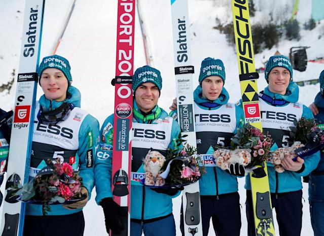 Ski Jumping - FIS World Cup - Men's Team - Vikersund, Norway - March 17, 2018. Domen Prevc, Jernej Damjan, Tilen Bartol and Peter Prevc of Slovenia celebrate their third place. NTB Scanpix/Terje Bendiksby via REUTERS ATTENTION EDITORS - THIS IMAGE WAS PROVIDED BY A THIRD PARTY. NORWAY OUT. NO COMMERCIAL OR EDITORIAL SALES IN NORWAY.