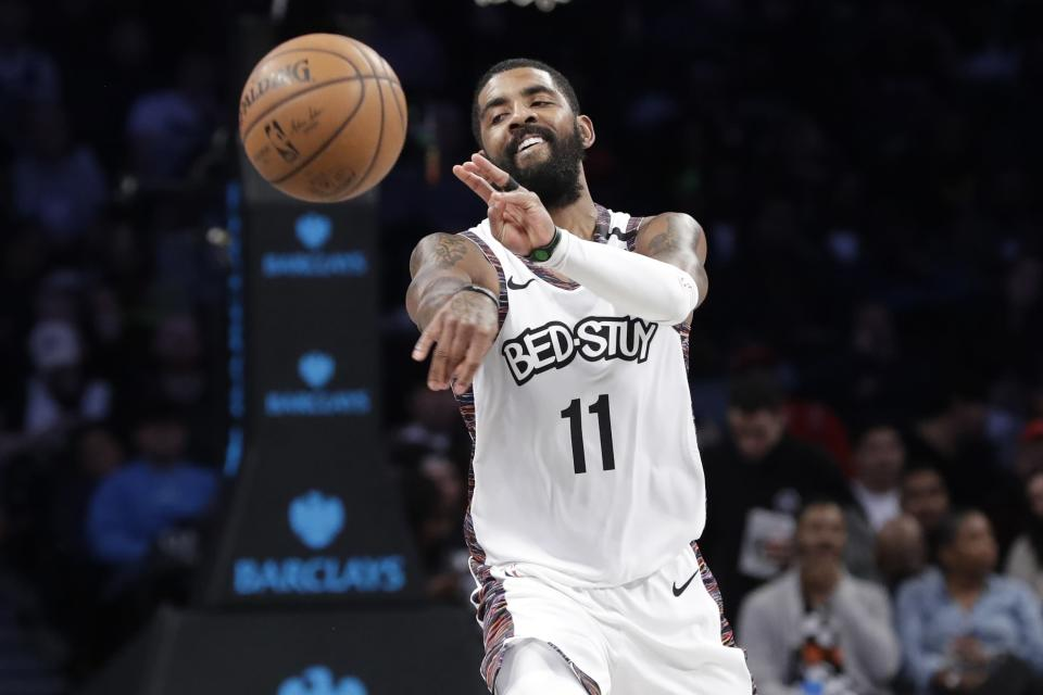 Brooklyn Nets' Kyrie Irving (11) passes the ball during the second half of the team's NBA basketball game against the Chicago Bulls on Friday, Jan. 31, 2020, in New York. The Nets won 133-118. (AP Photo/Frank Franklin II)