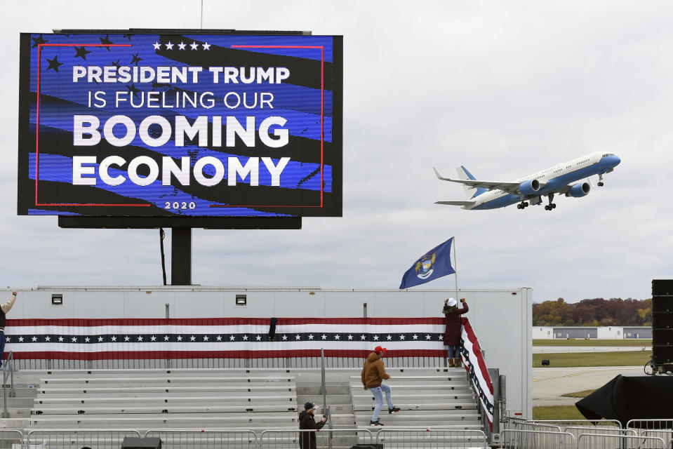 Air Force One, with President Donald Trump aboard, takes off from a campaign rally at Oakland County International Airport, Friday, Oct. 30, 2020, in Waterford Township, Mich. (AP Photo/Jose Juarez)