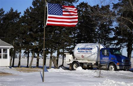 Arenson Oil and Propane delivery driver Don Bedford pulls the hose to fill up empty propane tanks in Sandwich, Illinois