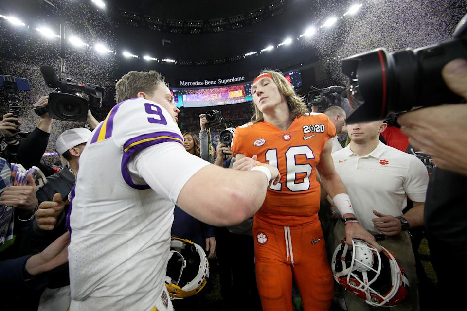 NEW ORLEANS, LOUISIANA - JANUARY 13: Joe Burrow #9 of the LSU Tigers talks with Trevor Lawrence #16 of the Clemson Tigers after their 42-25 win over Clemson Tigers in the College Football Playoff National Championship game at Mercedes Benz Superdome on January 13, 2020 in New Orleans, Louisiana. (Photo by Chris Graythen/Getty Images)