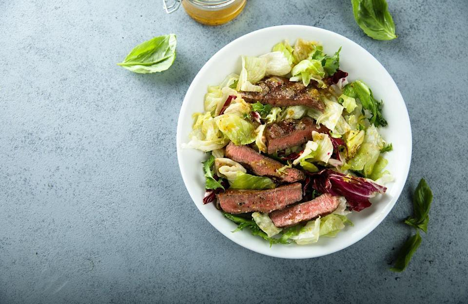 """<p>Steak and potatoes is a timeless dinner combination. But if you want to enjoy the two foods and still get in your leafy greens, try this salad recipe. The fresh herb vinaigrette adds some brightness yet still pairs well with steak and starch.</p> <p><a href=""""https://www.thedailymeal.com/recipes/herby-potatoes-and-steak-salad-recipe?referrer=yahoo&category=beauty_food&include_utm=1&utm_medium=referral&utm_source=yahoo&utm_campaign=feed"""" rel=""""nofollow noopener"""" target=""""_blank"""" data-ylk=""""slk:For the Herby Potatoes and Steak Salad recipe, click here."""" class=""""link rapid-noclick-resp"""">For the Herby Potatoes and Steak Salad recipe, click here.</a></p>"""