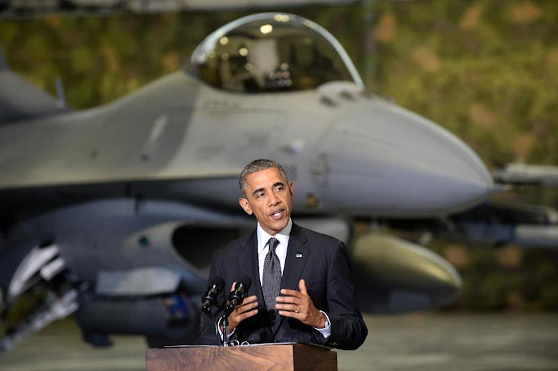 US President Barack Obama addresses US and Polish airmen in front of a F-16 fighter jet in a hangar at Warsaw Chopin Airport, Poland, on June 3, 2014