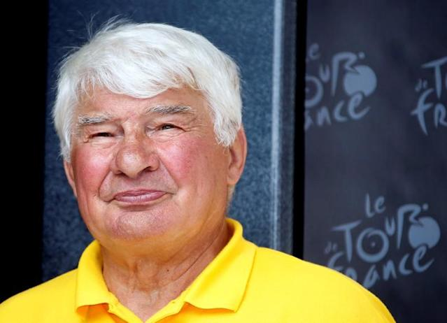 FILE PHOTO: Former French cyclist Raymond Poulidor is seen on the podium of the 168.5 km ninth stage of the centenary Tour de France cycling race from Saint-Girons to Bagneres-de-Bigorre