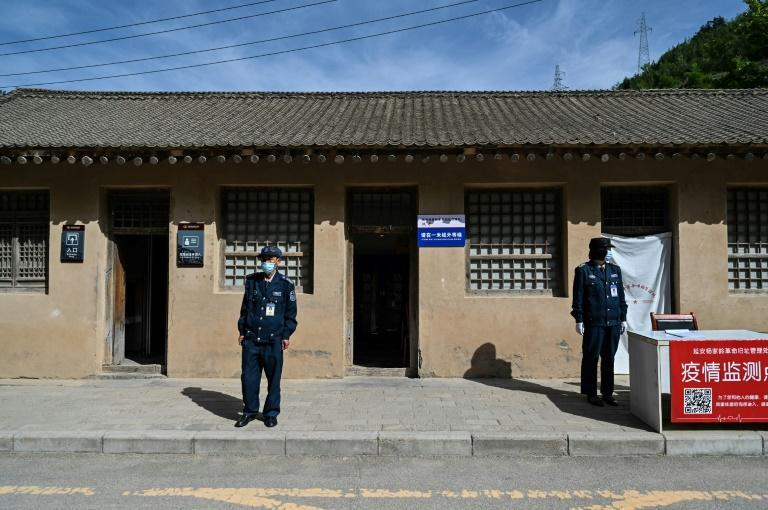 Guards stand outside a building during a government-organised media tour in Yan'an, a western Chinese city that bills itself as a 'Red Holy Land'