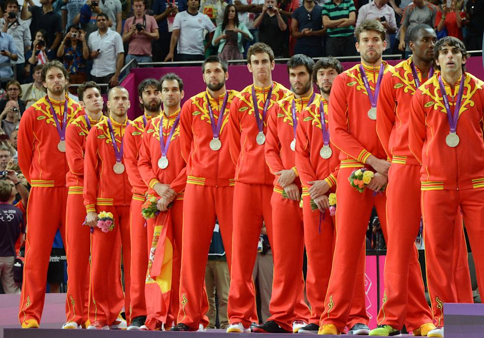 Spain's players pose on the podium after winning the silver medal in the London 2012 Olympic Games men's basketball competition at the North Greenwich Arena in London on August 12, 2012. The US won the gold medal followed by the silver to Spain and the bronze to Russia. AFP PHOTO /MARK RALSTON        (Photo credit should read MARK RALSTON/AFP/GettyImages)