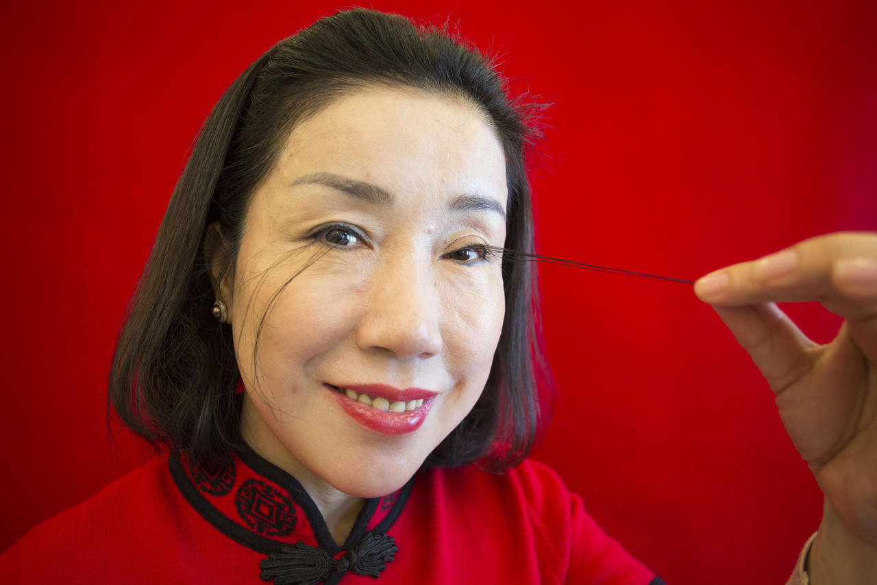 <p>The record for the Longest Eyelash is on You Jianxia's left eyelid, and is exactly 12.4 cm (4.88 inches) long. (PA) </p>