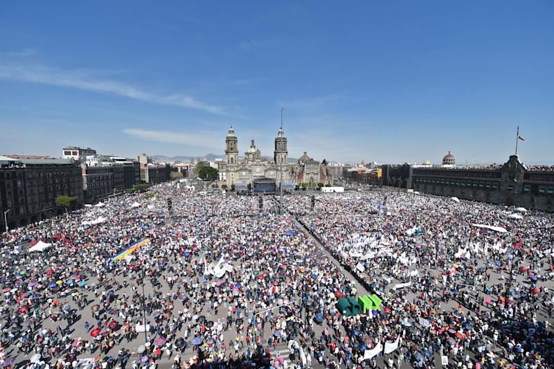 TOPSHOT - Aerial view of supporters of Mexican President Andres Manuel Lopez Obrador during a rally marking his first year in office at the Zocalo square in Mexico City on December 1, 2019. (Photo by PEDRO PARDO / AFP) (Photo by PEDRO PARDO/AFP via Getty Images)