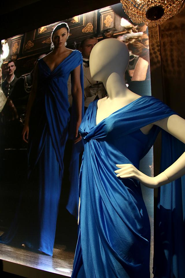 """<p><a rel=""""nofollow"""" href=""""https://www.yahoo.com/movies/tagged/gal-gadot"""">Gal Gadot</a> stunned in this blue gown (with room for a special accessory — her sword — in the back) in <a rel=""""nofollow"""" href=""""https://www.yahoo.com/movies/film/wonder-woman""""><em>Wonder Woman</em></a>'s ballroom scene. (Photo: Jacob Kramer/Yahoo Movies) </p>"""
