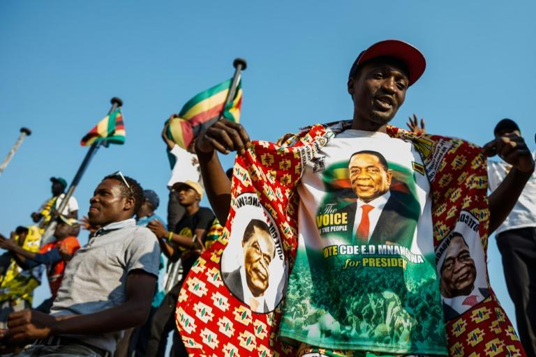 Supporters of Zimbabwe's ruling ZANU-PF party celebrate after Zimbabwe's top court threw out an opposition bid to overturn presidential election results