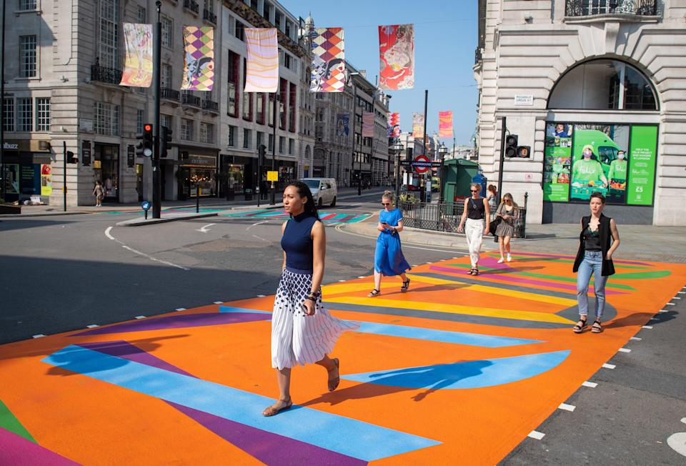 Pedestrians walk over a crossing designed by artist Vanessa Jackson at Piccadilly Circus (PA)
