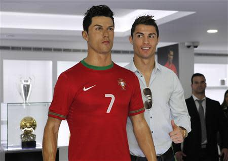 Cristiano Ronaldo poses with his statue during the inauguration of his museum in Funchal