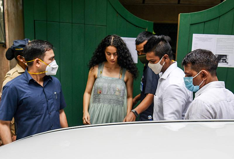 Bollywood actress Kangana Ranaut (C) visits her office 'Manikarnika Films' a day after structures within those premises were demolished under a decision of Brihanmumbai Municipal Corporation (BMC), in Mumbai on September 10, 2020. (Photo by Sujit Jaiswal / AFP) (Photo by SUJIT JAISWAL/AFP via Getty Images)