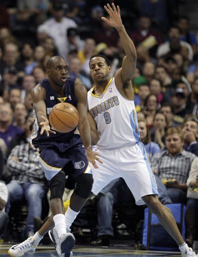 Denver Nuggets Andre Iguodala (9) guards Memphis Grizzlies Quincy Pondexter in the second quarter of a NBA game in Denver on Friday, Dec. 14, 2012.(AP Photo/Joe Mahoney)