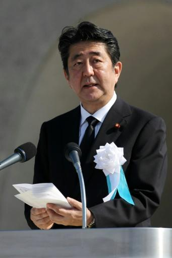 Japan's Prime Minister Shinzo Abe delivers a speech at the Hiroshima memorial service