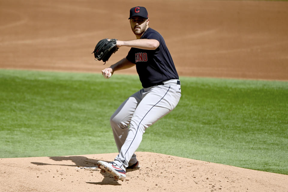 Cleveland Indians starting pitcher Aaron Civale throws in the first inning during a baseball game against the Texas Rangers in Arlington Texas, Sunday, Oct. 3, 2021. (AP Photo/Matt Strasen)