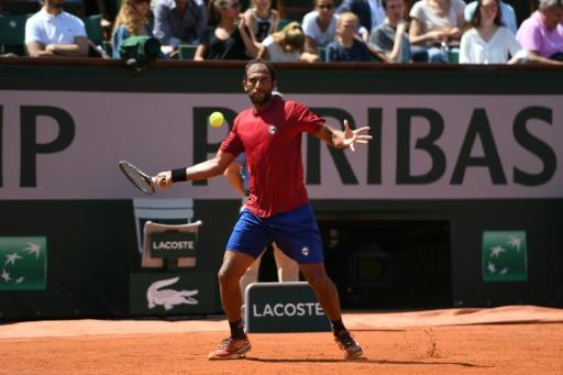 Egypt's Mohamed Safwat plays a return to Grigor Dimitrov on Philippe Chatrier Court