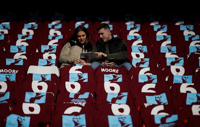 "Soccer Football - Premier League - Liverpool vs West Ham United - Anfield, Liverpool, Britain - February 24, 2018 West Ham fans and t-shirts in reference to Bobby Moore before the match Action Images via Reuters/Carl Recine EDITORIAL USE ONLY. No use with unauthorized audio, video, data, fixture lists, club/league logos or ""live"" services. Online in-match use limited to 75 images, no video emulation. No use in betting, games or single club/league/player publications. Please contact your account representative for further details."