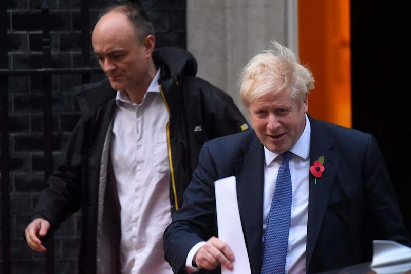 Political advisor Dominic Cummings leaves 10 Downing Street with Boris Johnson: Getty Images