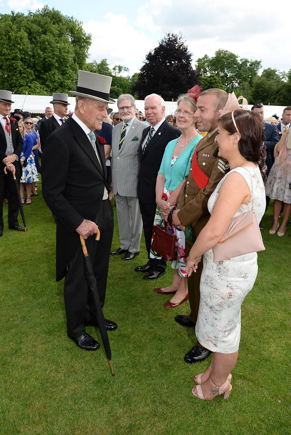 The Duke of Edinburgh speaking to guests at a garden party at Buckingham Palace in London. PRESS ASSOCIATION Photo. Picture date: Thursday June 1, 2017. See PA story ROYAL Garden. Photo credit should read: John Stillwell/PA Wire