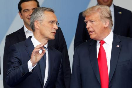 FILE PHOTO: U.S. President Donald Trump and NATO Secretary General Jens Stoltenberg speak at a NATO summit in Brussels, Belgium July 11, 2018.   REUTERS/Yves Herman/File Photo