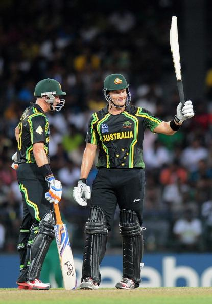 COLOMBO, SRI LANKA - SEPTEMBER 30:  Shane Watson of Australia raises his bat after scoring a half century as teammate David Hussey looks on during the Ninth super eight match between Australia and South Africa held at R. Premadasa Stadium on September 30, 2012 in Colombo, Sri Lanka.  (Photo by Pal Pillai/Getty Images,)