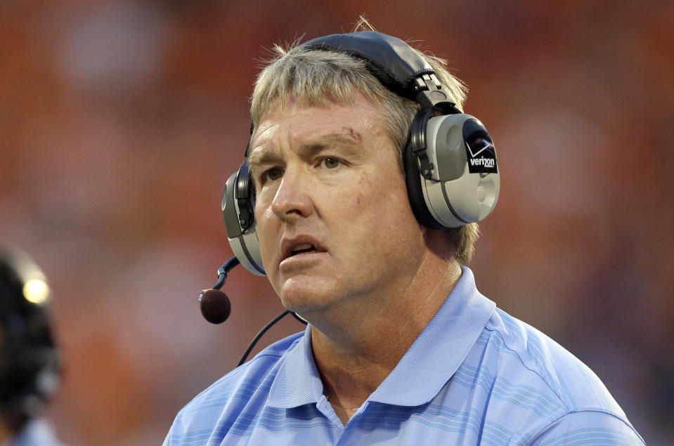 FILE - In this Sept. 27, 2014, file photo, Vic Koenning, at the time the defensive coordinator at North Carolina, watches during the first half of the team's NCAA college football game against Clemson in Clemson, S.C. West Virginia has placed defensive coordinator Koenning on administrative leave after a player alleged the assistant coach made a series of inappropriate comments. West Virginia athletic director Shane Lyons announced the move Tuesday, June 23, 2020, after safety Kerry Martin posted the allegations on his Twitter account. (AP Photo/Bob Leverone, File)