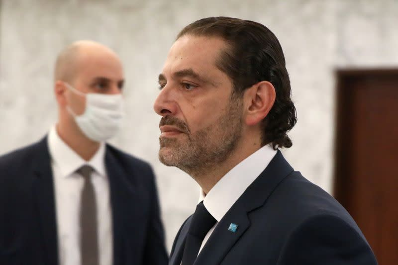 Prime Minister-designate Saad al-Hariri walks after meeting with Lebanon's President Michel Aoun at the presidential palace in Baabda